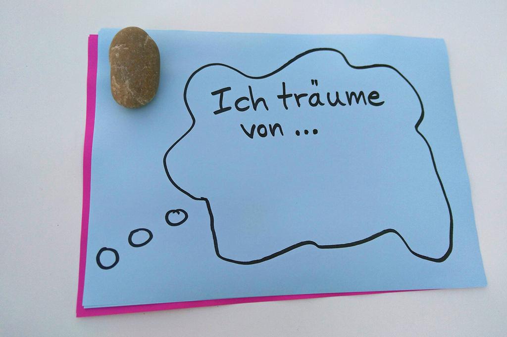 Ein Zettel mit einer Sprechblase und der Frage: Was ist dein Traum?